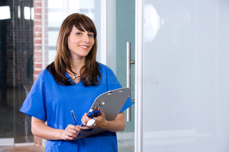 Female Nurse in a modern office. Holding a chart stock images