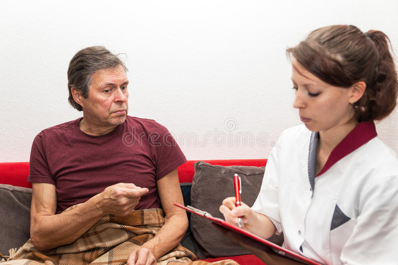 Female nurse with patient stock photo