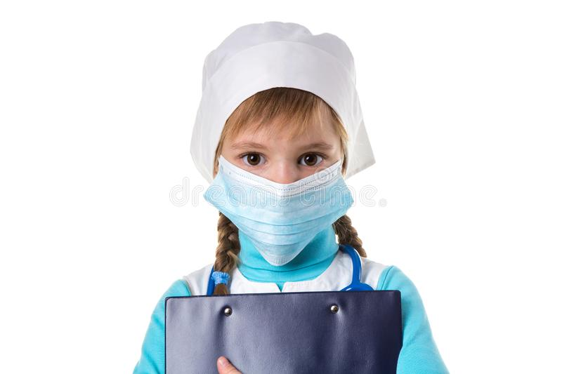 Female nurse wearing mask, holding a notebook looking straight at the camera, isolated on the white background. Female nurse with stethoscope, mask and notebook stock photo