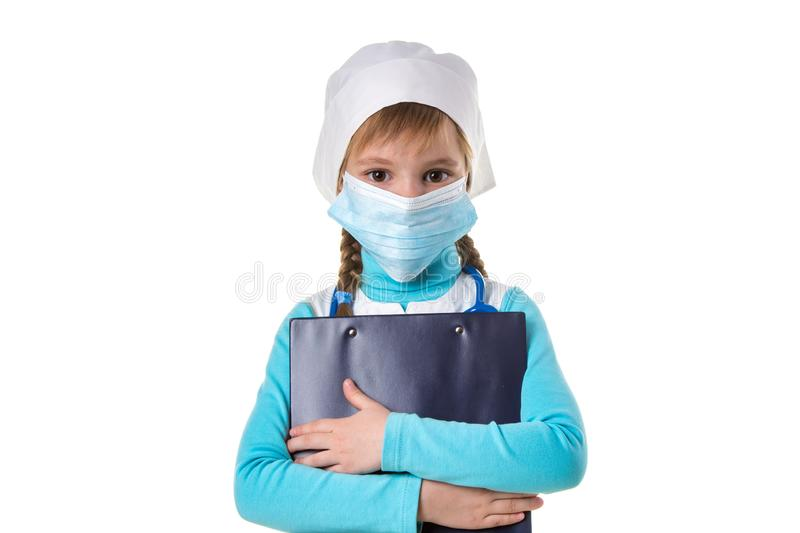 Female nurse wearing mask, hugs a notebook, looking straight at the camera, isolated on the white background, landscape. Female nurse wearing mask, hugs a stock image