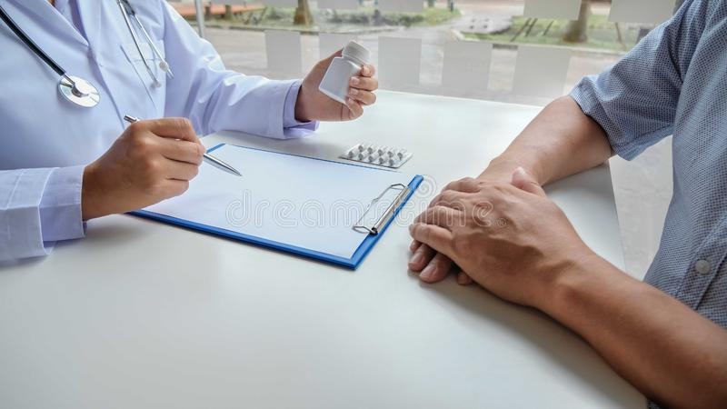Female nurses explained and recommended treatment along with a prescription after the patient saw a doctor and got results stock photography
