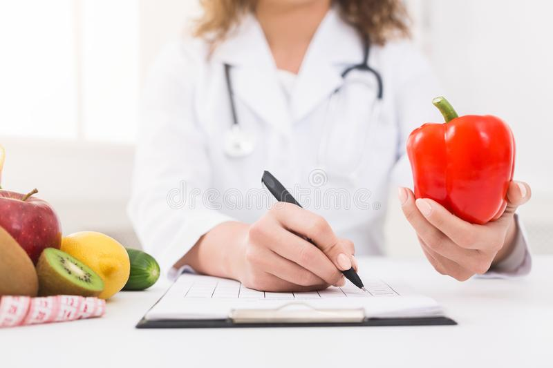 Female nutritionist counting calories in hospital, closeup royalty free stock photos