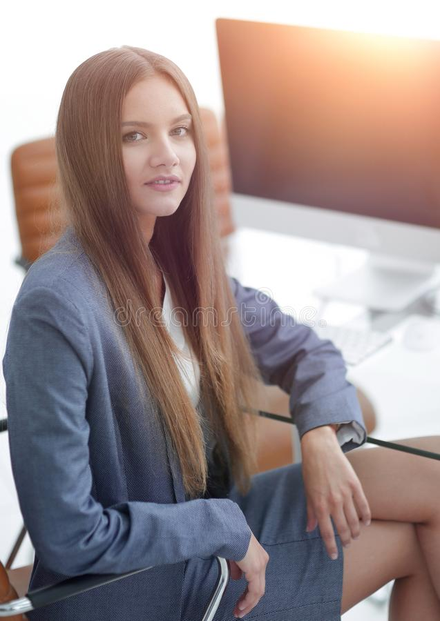Female office employee sitting at a Desk. Portrait of young female office employee sitting at a Desk stock photo