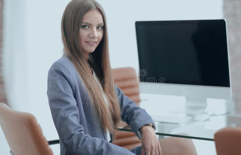 Female office employee sitting at a Desk. Portrait of young female office employee sitting at a Desk stock photos
