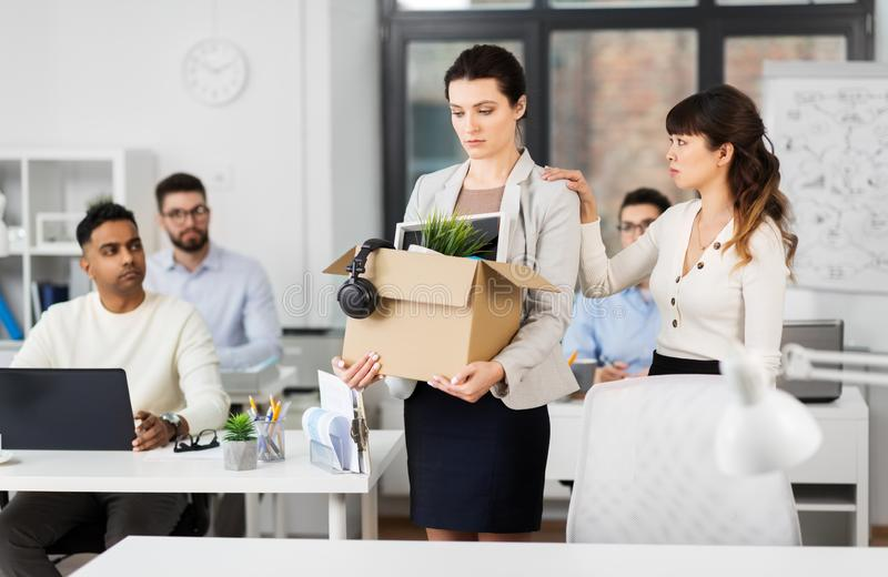 Female office worker with box of personal stuff royalty free stock photography