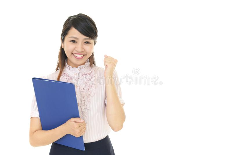 Business woman enjoying success. The female office worker who poses happily royalty free stock images