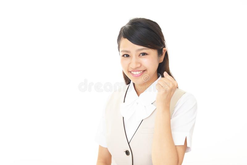 Smiling business woman. The female office worker who poses happily stock images