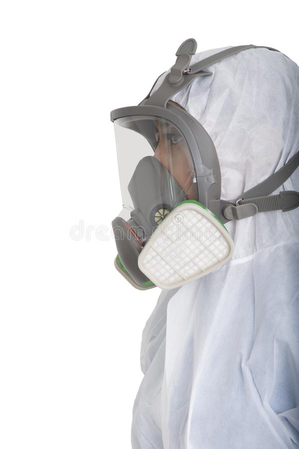 Female officer wearing gas mask and pollution protection suit. On white background royalty free stock image