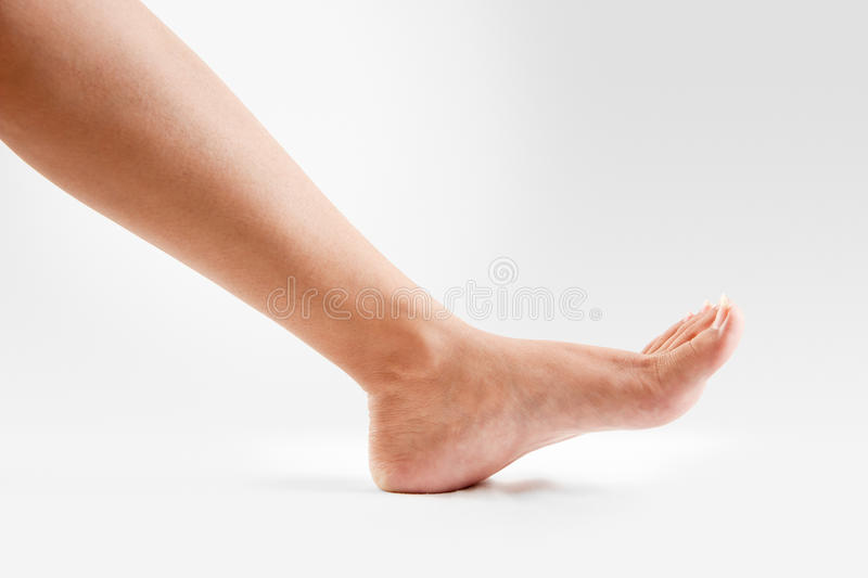 Female one feet royalty free stock images