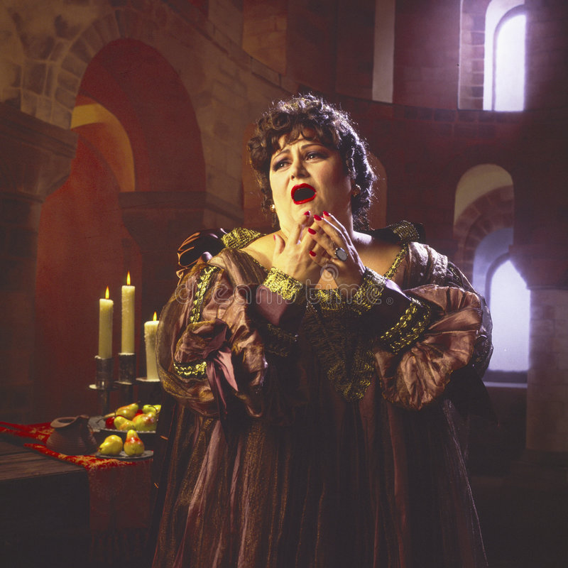 Female opera singer_3. Opera diva in full singing mode royalty free stock photo