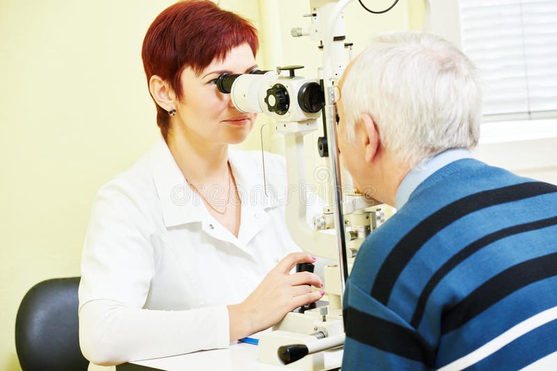Female ophthalmologist or optometrist at work. Optometry concept. female optometrist optician doctor examines eyesight of female patient in eye ophthalmological royalty free stock photos