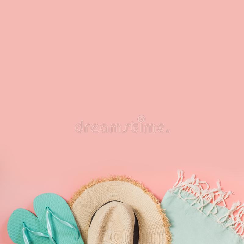 Female outfit for beach. Straw sunhat and beach slaps on punchy pink with space for text. Summer concept stock images