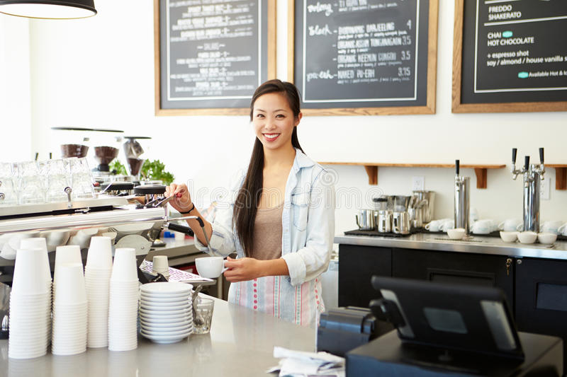 Female Owner Of Coffee Shop. Smiling to Camera stock photo