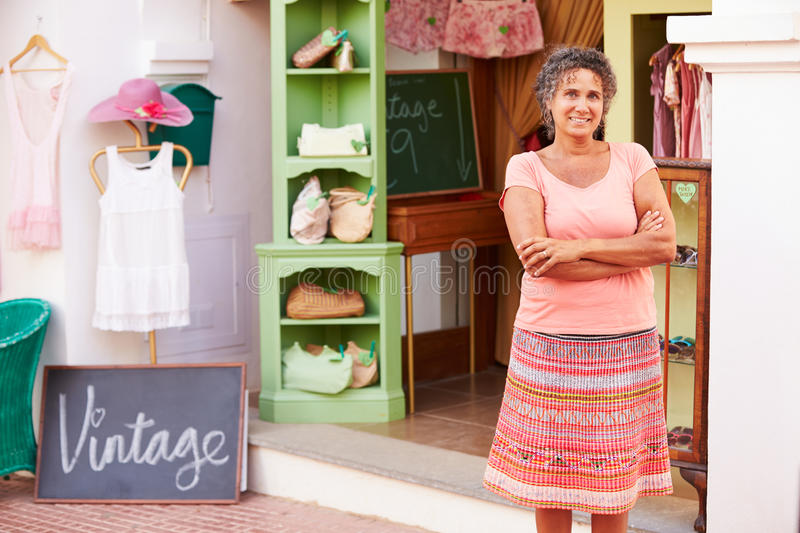 Female Owner Of Fashion Store Standing Outside Shop stock photos