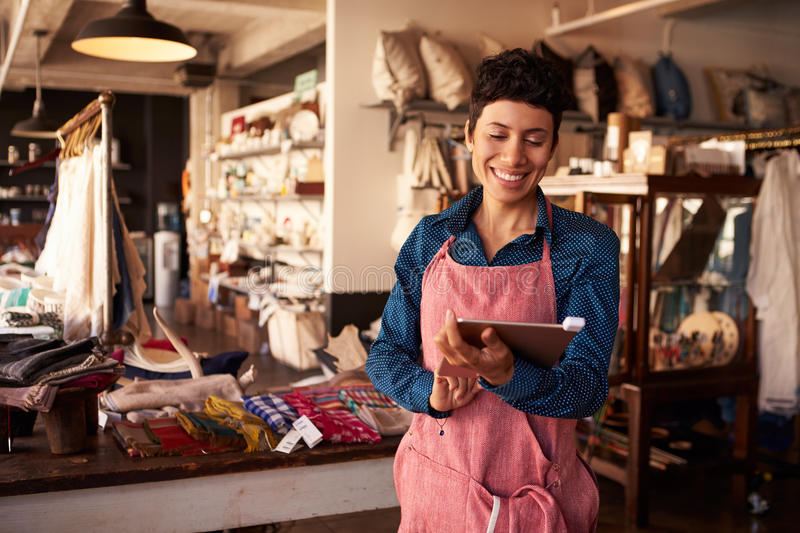 Female Owner Of Gift Store With Digital Tablet royalty free stock image