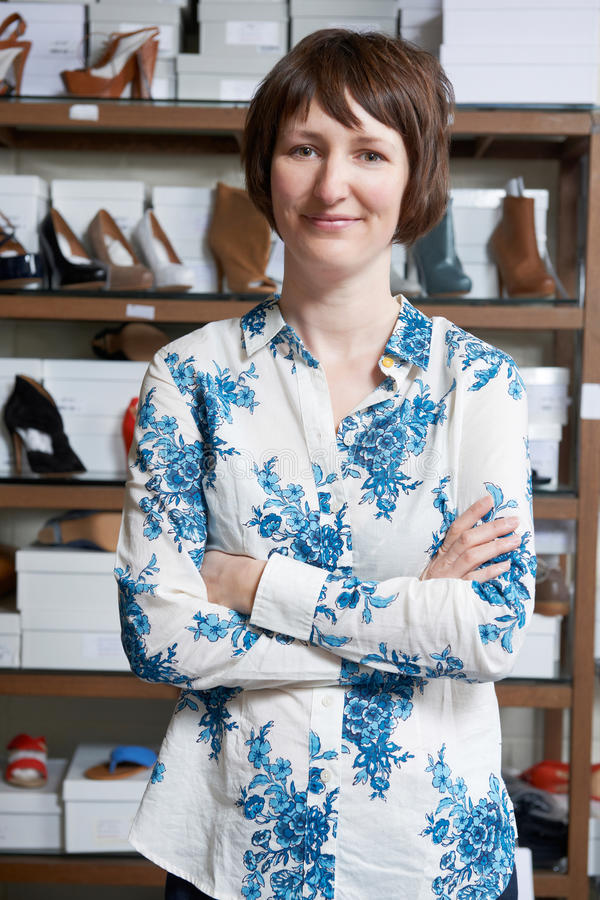 Female Owner Of Shoe Store. Portrait Of Female Owner Of Shoe Store royalty free stock images