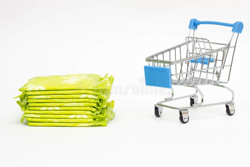 Female pads in a shopping trolley on a white background, personal hygiene shopping concept, close-up, copy space stock images