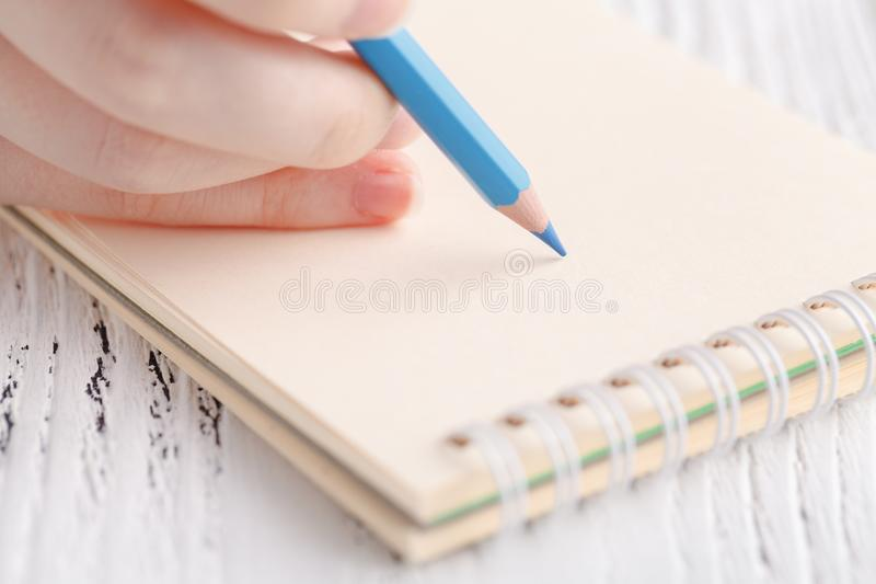 Female painting in notebook royalty free stock images