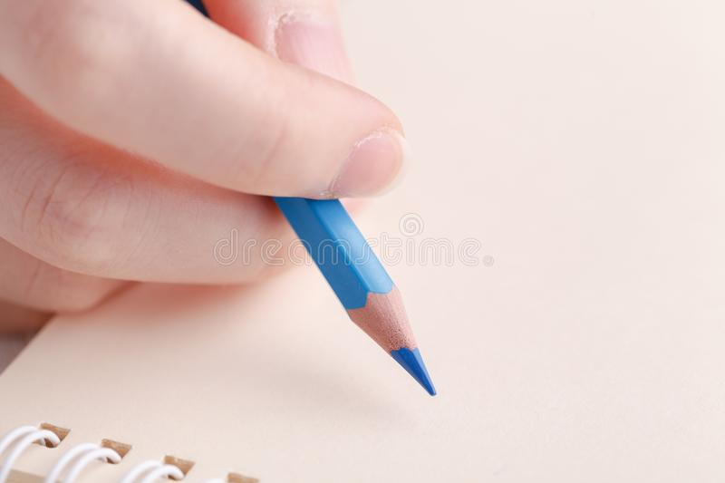 Female painting in notebook royalty free stock photos