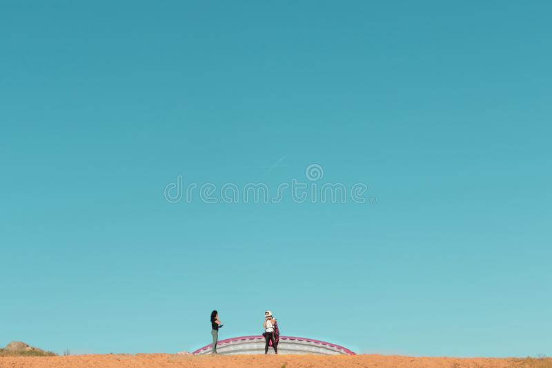 Female paraglider pilot preparing to take off talking to a woman stock photos