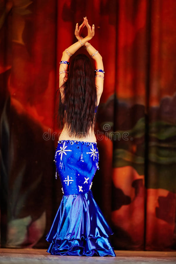Female participant of Bellydance Superiority of Moscow. MOSCOW - JAN 28: Female participant of Bellydance Superiority of Moscow in blue dress embroidered with royalty free stock photos
