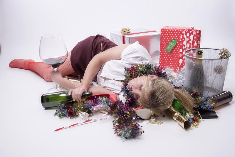 Female party goer sleeping on floor. Woman enjoying herself at a party - November 2016 - Party goer sleeping on the floor stock photo