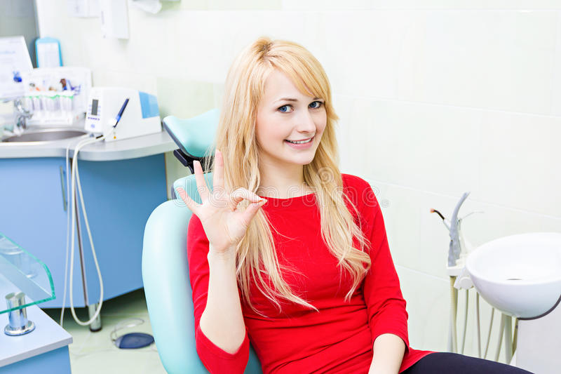 Female patient in dentist office stock photography