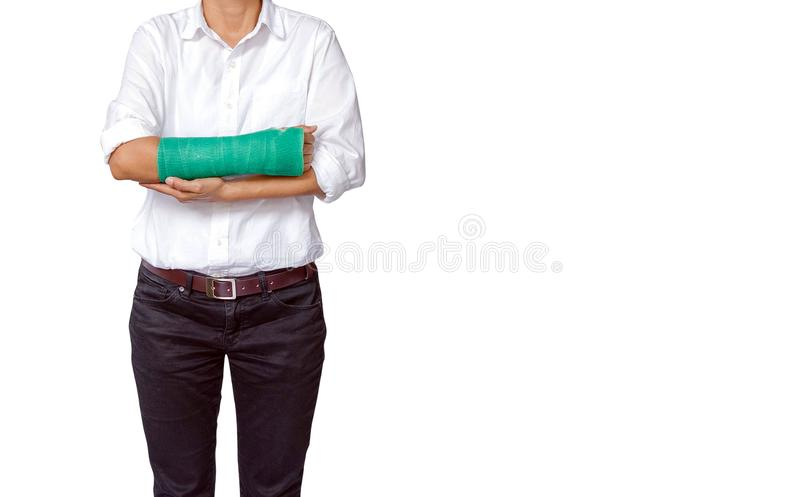 female patient with a green cast on arm isolated on white, clipping path included, body injury concept royalty free stock photos
