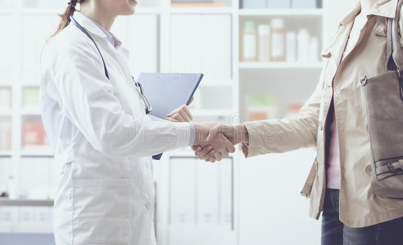 Doctor and patient meeting in the office stock photography