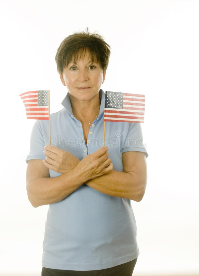 Female patriot American with flags royalty free stock photography