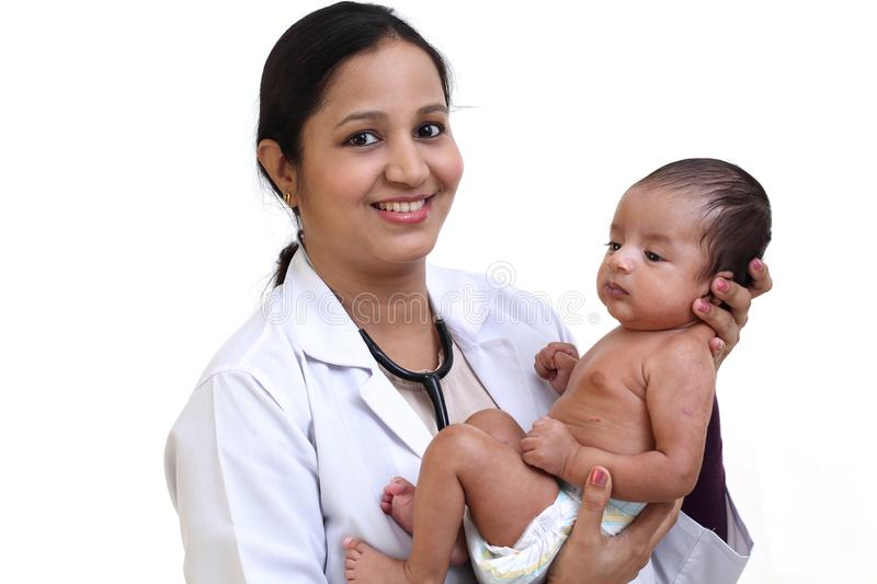 Female pediatrician holds newborn baby royalty free stock images