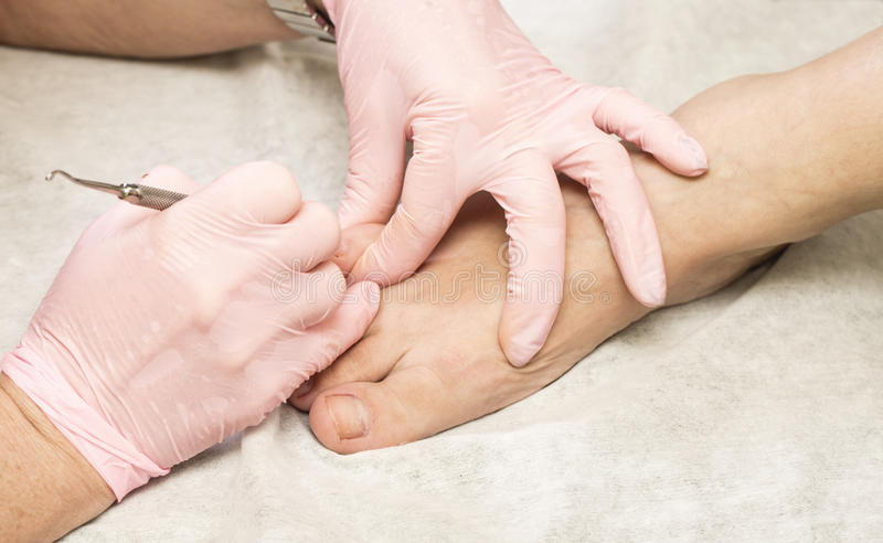 Female pedicure. Care of feet in a medical office royalty free stock image