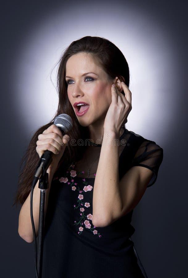 Female Performer Sing Handheld Acoustic Microphone stock image