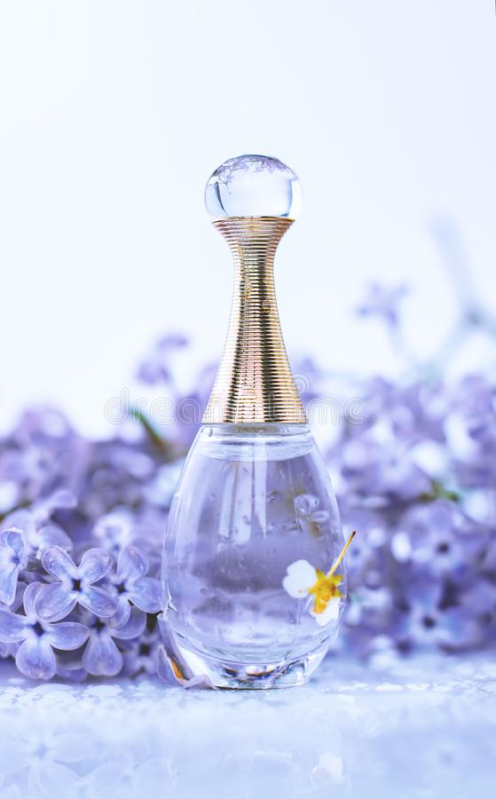 Female perfume with flowers stock photo