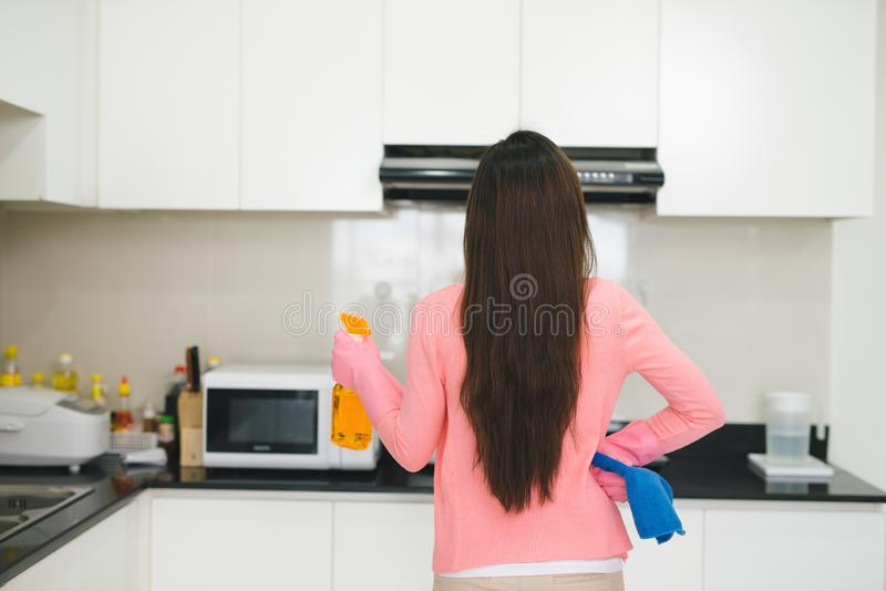 Female person ready for cleaning stock images