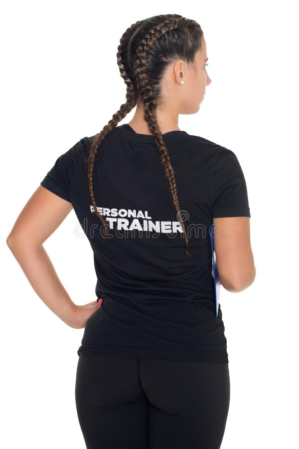 Female Personal Trainer. With his back facing the camera, isolated stock photo