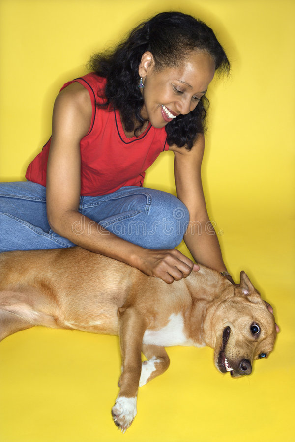 Female petting dog.