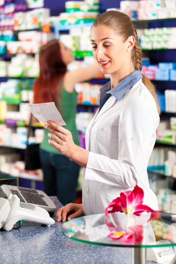 Female Pharmacist In Her Pharmacy Royalty Free Stock Photos