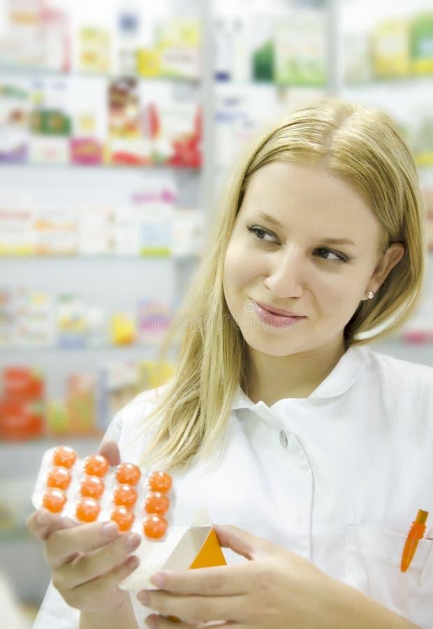 Female Pharmacist holding medicine royalty free stock photo