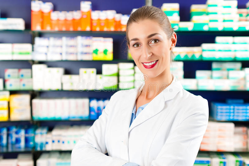 Female Pharmacist in pharmacy royalty free stock photos