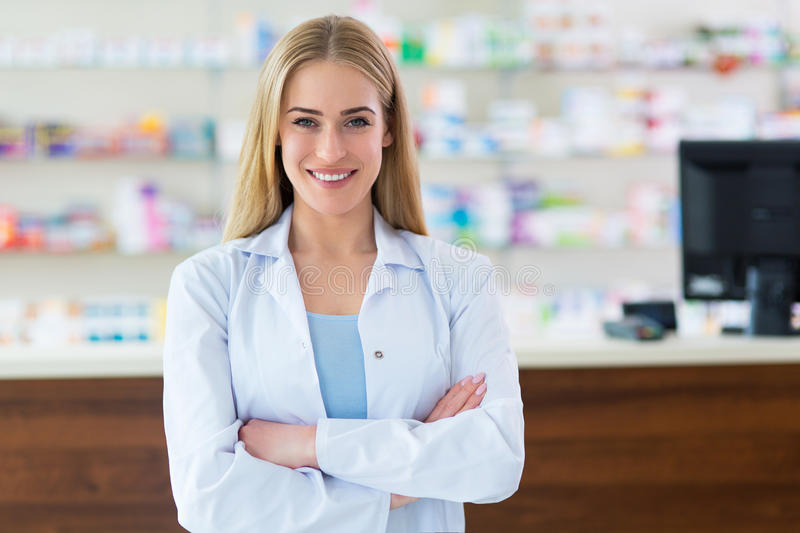 Female pharmacist. In pharmacy, searching the right medicine