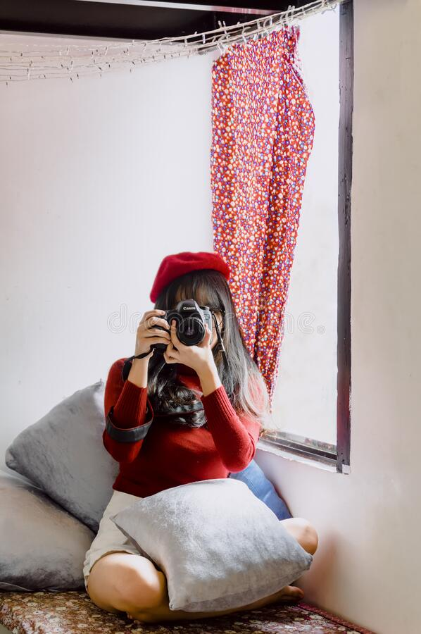 Female photographer with camera royalty free stock photography