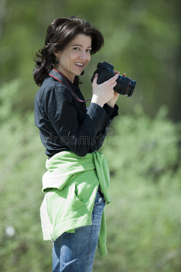 Female photographer in a forest. royalty free stock photo