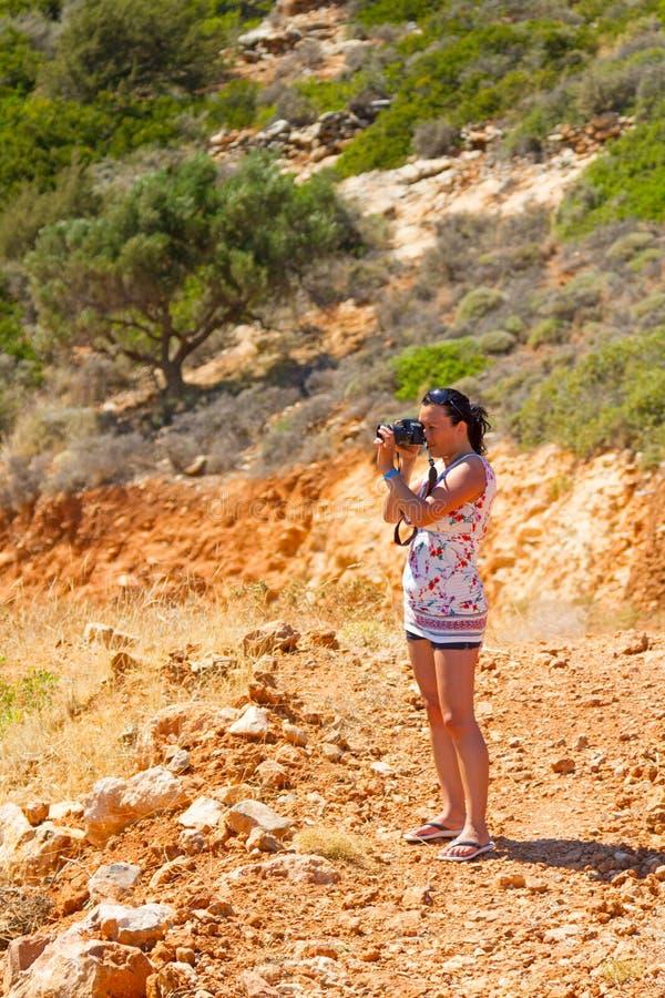 Female Photographer In Greek Scenery Stock Image
