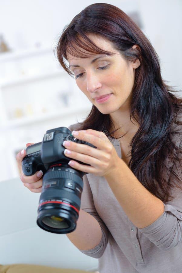 Female photographer holding professional camera royalty free stock photography