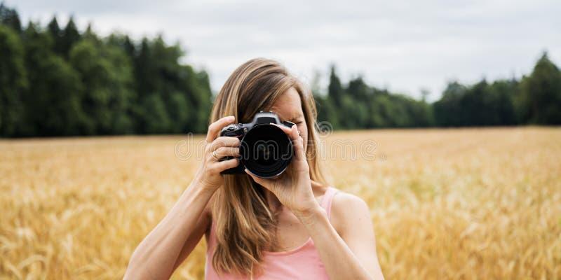 Female photographer taking photos outside royalty free stock image