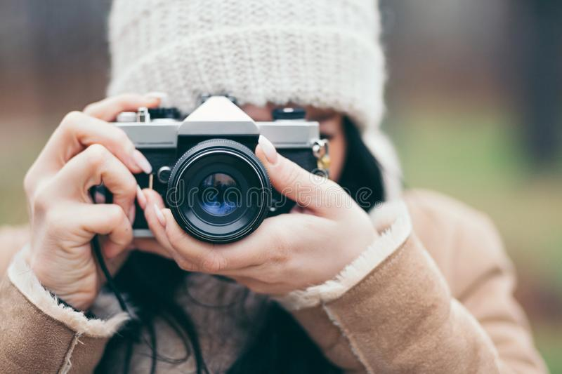 Female photographer taking pictures outdoors with a vintage camera stock images