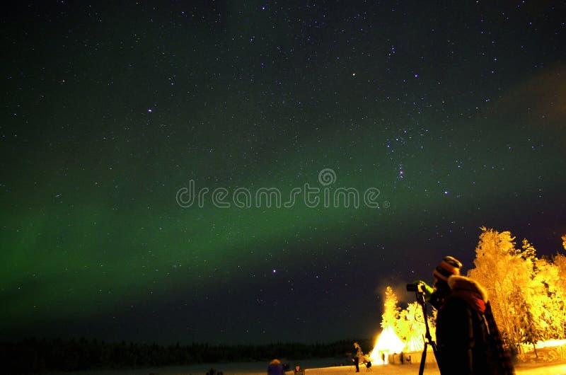 Female Photographer under Aurora stock photography
