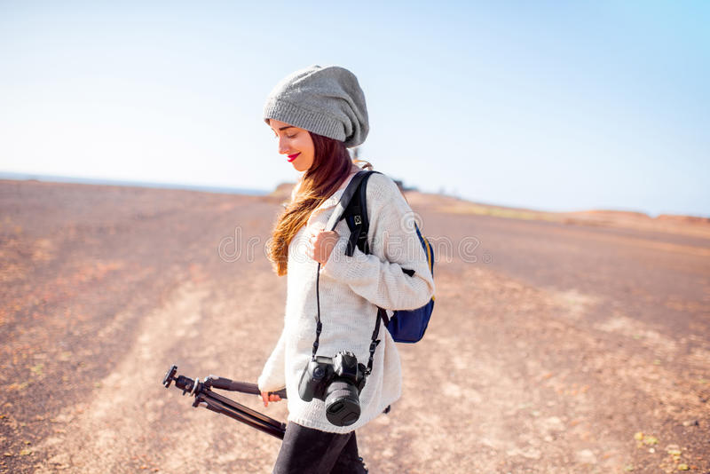 Female photographer walking outdoors stock images