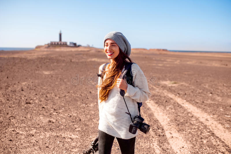 Female photographer walking outdoors stock photography